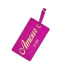 Etichetta fucsia per valigia con scritta amour